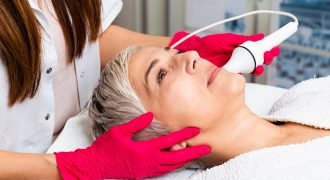 woman undertaking microdermabrasion | scar removal