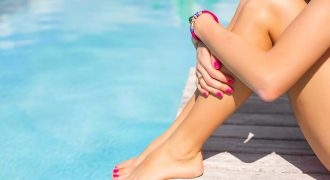 woman with pink nails sitting by pool | manicure + pedicure